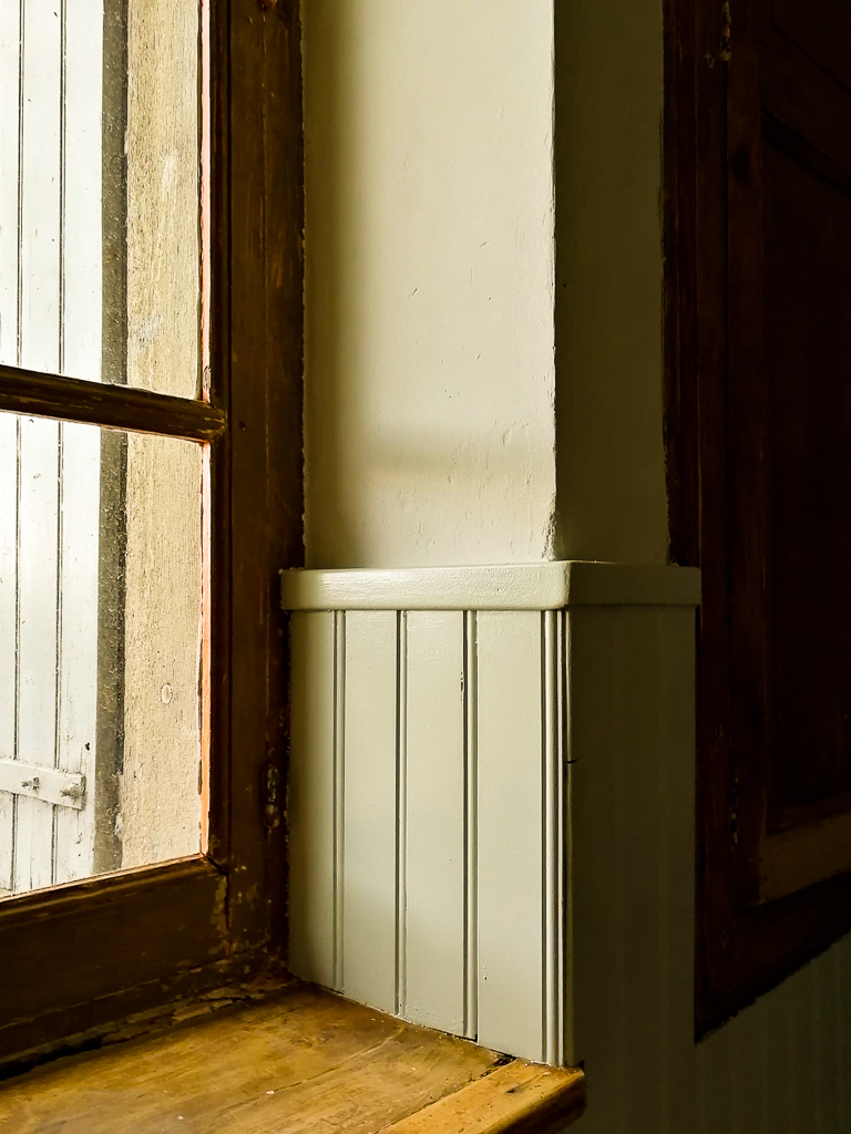 the walls and tongue and groove panelling were painted in two different shades of light dusty sage