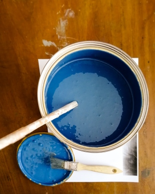 Tin of dark indigo paint