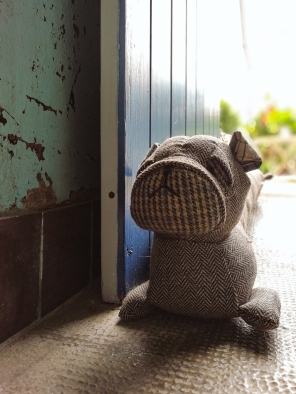 Dog shaped door stopper