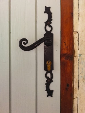 Old door handle restored to its former glory