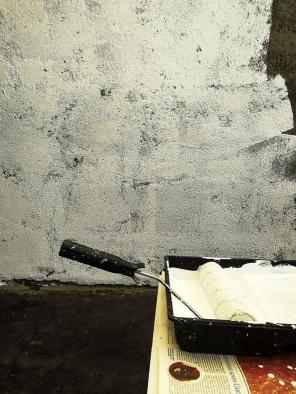 priming a concrete wall
