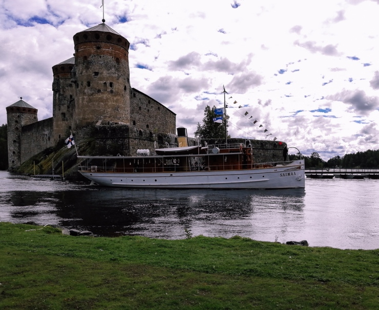 olavinlinna castle in Finland and Saimaa lake boat