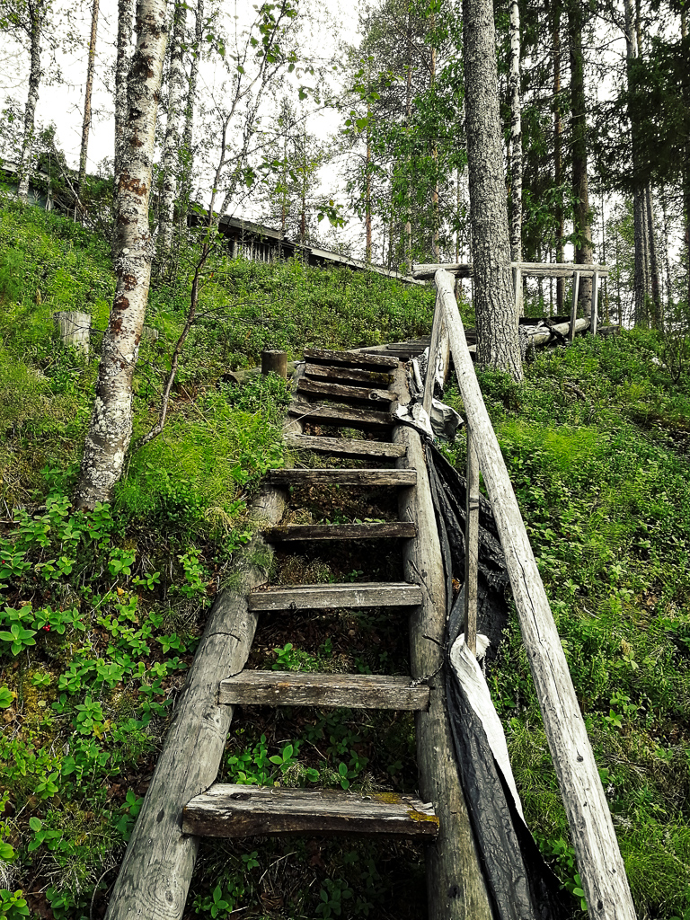 steep steps leading up to a summer cabin