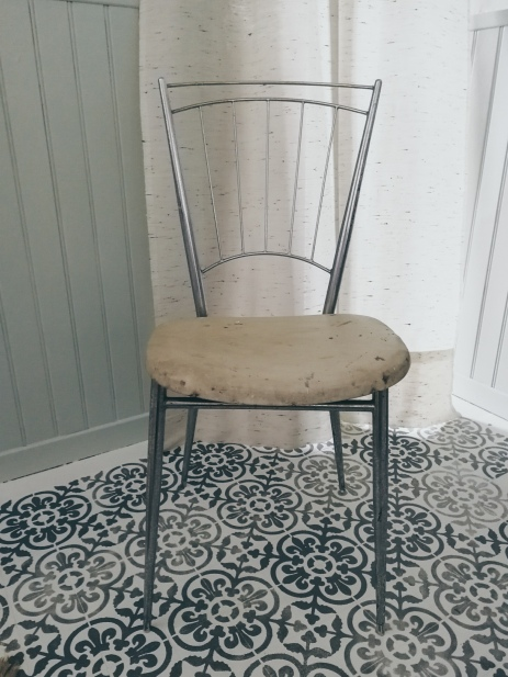 Before: a metal framed chair, ready to be upholstered
