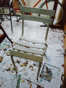 this is the chair before any cleaning or stripping with its white paint-job, covering the legs, the seat and the back