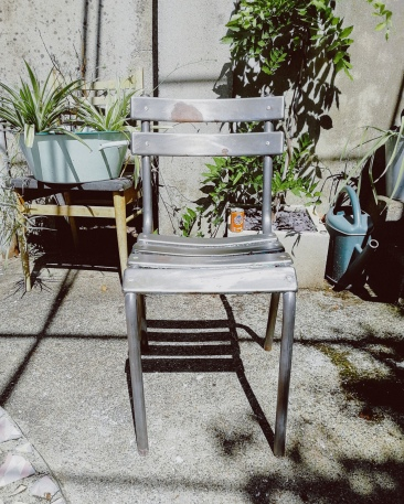 aluminium chair drying in the garden after paint stripping