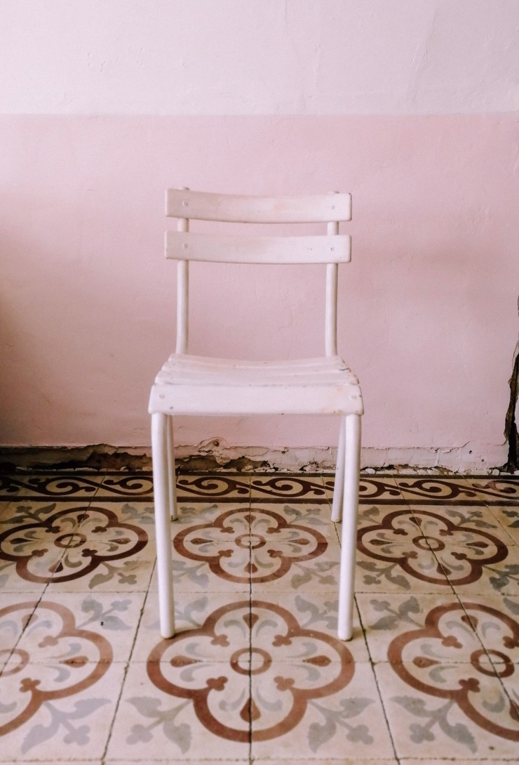 old aluminium chair with its white paint job